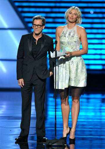 Kevin Bacon, left, and Maria Sharapova present an award at the ESPY Awards on Wednesday, July 17, 2013, at the Nokia Theater in Los Angeles. &#40;Photo by John Shearer&#47;Invision&#47;AP&#41; <span class=meta>(Photo&#47;John Shearer)</span>