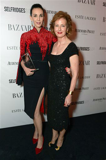 L'Wren Scott, winner of the Harper's Bazaar Tastemaker of the Year Award and Julia Peyton-Jones attend Harper's Bazaar Women of the Year Awards 2013 at Claridge's Hotel on Tuesday, Nov. 5, 2013, in London. (Photo by Jon Furniss/Invision for Harper's Bazaar/AP)