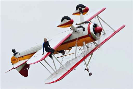A wing walker performs at the Vectren Air Show just before crashing, Saturday, June 22, 2013, in Dayton, Ohio. The crash killed the pilot and the stunt walker instantly, authorities said. &#40;AP Photo&#47;Thanh V Tran&#41; <span class=meta>(AP Photo&#47; Thanh V Tran)</span>