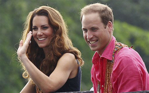 "<div class=""meta ""><span class=""caption-text "">Britain's Prince William and his wife Kate, the Duke and Duchess of Cambridge, smile as they watch a shark ceremony as they arrive at Marapa Island, Solomon Islands, Monday, Sept. 17, 2012. (AP Photo/Rick Rycroft, Pool) (AP Photo/ Rick Rycroft)</span></div>"
