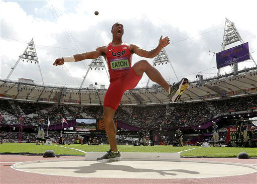 United States&#39; Ashton Eaton reacts after his throw in the shot put in the decathlon during the athletics in the Olympic Stadium at the 2012 Summer Olympics, London, Wednesday, Aug. 8, 2012. &#40;AP Photo&#47;David J. Phillip&#41; <span class=meta>(AP Photo&#47; David J. Phillip)</span>
