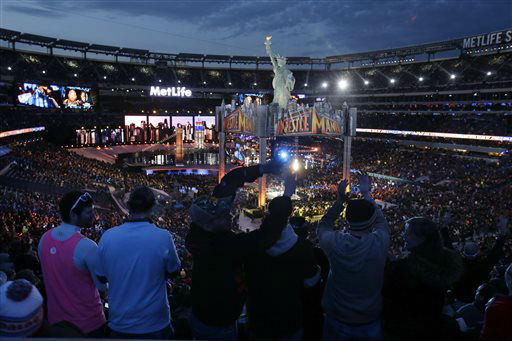 "<div class=""meta image-caption""><div class=""origin-logo origin-image ""><span></span></div><span class=""caption-text"">Fans watch the WWE Wrestlemania 29 wrestling event, Sunday, April 7, 2013, in East Rutherford, N.J. (AP Photo/Mel Evans) (AP Photo/ Mel Evans)</span></div>"
