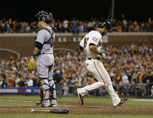 San Francisco Giants&#39; Angel Pagan scores on a sacrifice fly by Hunter Pence during the eighth inning of Game 2 of baseball&#39;s World Series against the Detroit Tigers Thursday, Oct. 25, 2012, in San Francisco. Detroit Tigers&#39; Gerald Laird is at left. &#40;AP Photo&#47;Marcio Jose Sanchez&#41; <span class=meta>(AP Photo&#47; Marcio Jose Sanchez)</span>