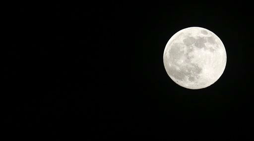 "<div class=""meta ""><span class=""caption-text "">A full moon rises over Jackson, Miss., Saturday, June 22, 2013. The moon, which will reach its full stage on Sunday, is expected to be significantly closer to earth during a phenomenon known as supermoon. (AP Photo/Rogelio V. Solis) (AP Photo/ Rogelio V. Solis)</span></div>"