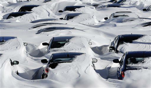 Snow begins to melt on cars parked at a dealership after a winter storm in Hartford, Conn., Sunday, Feb. 10, 2013.  A howling storm across the Northeast left much of the New York-to-Boston corridor covered with more than three feet of snow on Friday into Saturday morning. &#40;AP Photo&#47;Jessica Hill&#41; <span class=meta>(AP Photo&#47; Jessica Hill)</span>