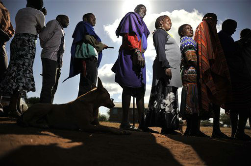 Masaai line up to vote in a general election in Ilbissil, Kenya, Monday March 4, 2013. Five years after more than 1,000 people were killed in election-related violence, Kenyans went to the polls on Monday to begin casting votes in the nationwide election seen as the country&#39;s most important - and complicated - in its 50-year history. &#40;AP Photo&#47;Riccardo Gangale&#41; <span class=meta>(AP Photo&#47; Riccardo Gangale)</span>