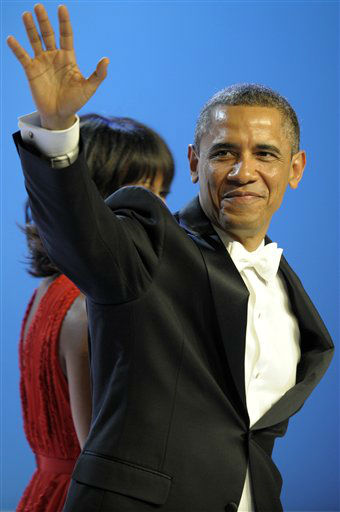 President Barack Obama waves has he leaves The Inaugural Ball at the Washignton convention center during the 57th Presidential Inauguration in Washington, Monday, Jan. 21, 2013. &#40;AP Photo&#47;Cliff Owen&#41; <span class=meta>(AP Photo&#47; Cliff Owen)</span>