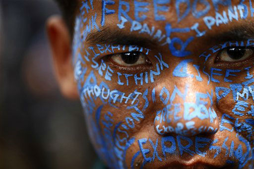 "<div class=""meta ""><span class=""caption-text "">A Nepalese artist appears with his face painted during a protest outside the Katmandu District administration office in Katmandu, Nepal, Thursday, Sept. 13, 2012. The protesting artists alleged that Nepalese artist Manish Harijan had received death threats from activists of Nepal based World Hindu Federation after displaying combination images of Hindu deities and Western super heroes. (AP Photo/Niranjan Shrestha) (AP Photo/ Niranjan Shrestha)</span></div>"
