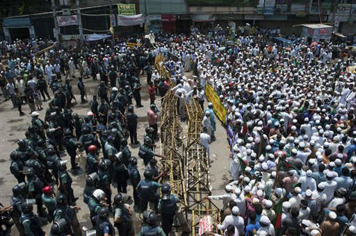 "<div class=""meta ""><span class=""caption-text "">Islamic activists, right side, block a road in Dhaka, Bangladesh on Sunday, May 5, 2013 during a protest to demand that the government enact an anti-blasphemy law. The government in this Muslim-majority nation has rejected the groups' demands, saying Bangladesh is governed by secular liberal laws. (AP Photo/Rahul Talukder) (AP Photo/ Rahul Talukder)</span></div>"