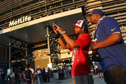 "<div class=""meta image-caption""><div class=""origin-logo origin-image ""><span></span></div><span class=""caption-text"">Fans take photos as they arrive before an NFL football game between the New York Giants and the Dallas Cowboys Wednesday, Sept. 5, 2012, in East Rutherford, N.J.   (AP Photo/Seth Wenig)</span></div>"
