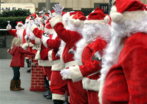 "<div class=""meta ""><span class=""caption-text "">A young girl makes a donation to the Volunteers of America Santas during their 110th annual Sidewalk Santa Parade, in New York,  Friday, Nov. 23, 2012. The donations they raise are used for a holiday food voucher program for needy residents. (AP Photo/Richard Drew) (AP Photo/ Richard Drew)</span></div>"