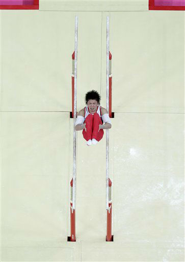 Japanese gymnast Kohei Uchimura performs on the parallel bars during the Artistic Gymnastic men&#39;s individual all-around competition at the 2012 Summer Olympics, Wednesday, Aug. 1, 2012, in London. &#40;AP Photo&#47;Julie Jacobson&#41; <span class=meta>(AP Photo&#47; Julie Jacobson)</span>