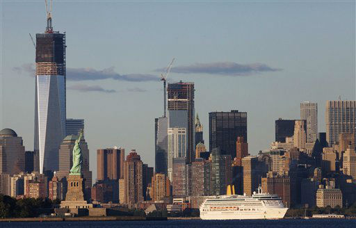 A cruiseship passes the World Trade Center in New York and the Statue of Liberty, left, Monday, Sept. 10, 2012 in this photo taken from Bayonne, N.J. Tuesday will mark the eleventh anniversary of the terrorist attacks of Sept. 11, 2001.  The tallest tower is 1 World Trade Center, now up to 105 floors. and in the center is 4 World Trade Center, also under construction. &#40;AP Photo&#47;Mark Lennihan&#41; <span class=meta>(AP Photo&#47; Mark Lennihan)</span>