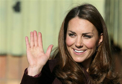 Britain&#39;s Kate, Duchess of Cambridge, greets members of the public during a visit to Elswick Park, Newcastle, England, Wednesday, Oct. 10, 2012. Britain&#39;s Duchess of Cambridge visited a local community group and school children inside a community garden. &#40;AP Photo&#47;Scott Heppell&#41; <span class=meta>(AP Photo&#47; SCOTT HEPPELL)</span>