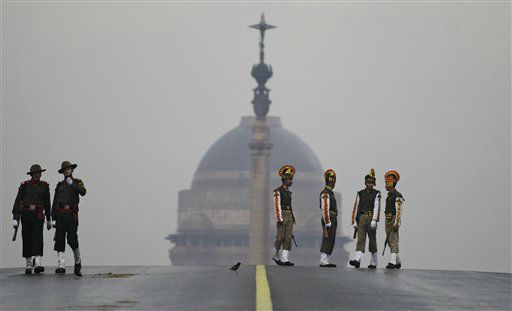 A group of Indian paramilitary soldiers, right, stand with the backdrop of the Presidential Palace during rehearsals for India?s Republic Day parade in New Delhi, India, Friday, Jan. 18, 2013. India marks Republic Day on Jan. 26 with military parades and festivities across the country. (AP Photo/Altaf Qadri)
