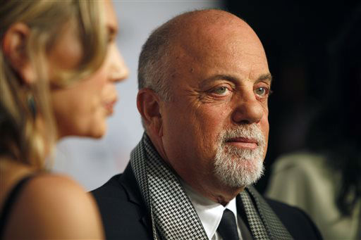 Billy Joel arrives at the Elton John AIDS Foundation&#39;s 12th Annual &#34;An Enduring Vision&#34; benefit gala at Cipriani Wall Street on Tuesday, Oct. 15, 2013 in New York. &#40;Photo by Carlo Allegri&#47;Invision&#47;AP&#41; <span class=meta>(Photo&#47;Carlo Allegri)</span>