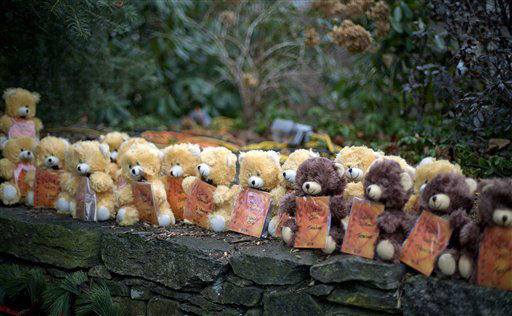 Teddy bears, each representing a victim of the Sandy Hook Elementary School shooting, sit on a wall at a sidewalk memorial, Sunday, Dec. 16, 2012, in Newtown, Conn. A gunman walked into Sandy Hook Elementary School in Newtown Friday and opened fire, killing 26 people, including 20 children. &#40;AP Photo&#47;David Goldman&#41; <span class=meta>(AP Photo&#47; David Goldman)</span>