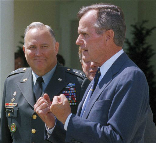 "<div class=""meta image-caption""><div class=""origin-logo origin-image ""><span></span></div><span class=""caption-text"">FILE - In this April 23, 1991 file photo,  Gen. Norman Schwarzkopf, left, looks on as President George Bush speaks to reporters in the White House Rose Garden as in Washington. Bush praised the general for leading a ""fantastic"" effort to fulfill U.S. obligations in the gulf, and for helping to build ""unbelievable"" morale on the home front. Schwarzkopf died Thursday, Dec. 27, 2012 in Tampa, Fla. He was 78. (AP Photo/Barry Thumma, File) (AP Photo/ Barry Thumma)</span></div>"