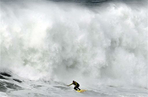 "<div class=""meta ""><span class=""caption-text "">US surfer Garrett McNanamara rides a wave during a surf session at Praia do Norte beach in Nazare, Portugal, Wednesday, Jan. 30, 2013. McNamara is said to have broken his own world record for the largest wave surfed when he caught a wave reported to be around 100ft, off the coast of Nazare on Monday. If the claims are verified, it will mean that McNamara, who was born in Pittsfield, Massachusetts, USA, but whose family moved to Hawaii's North Shore when he was aged 11, has beaten his previous record, which was also set at Nazare, of 23.77 meters (78 feet) in November 2011. (AP Photo/Francisco Seco)</span></div>"
