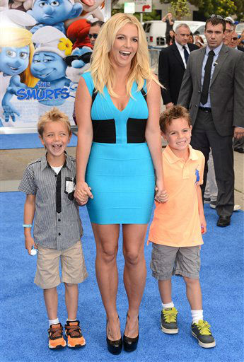 "Singer Britney Spears, center, and her sons Sean Federline and Jayden James Federline arrive at the world premiere of ""The Smurfs 2"" at the Regency Village Theatre on Sunday, July 28, 2013 in Los Angeles. (Photo by Jordan Strauss/Invision/AP)"