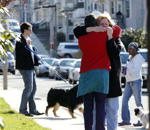 Neighbors hug outside the home of the Richard family in the Dorchester neighborhood of Boston, Tuesday, April 16, 2013.  Martin Richard, 8,  was killed in Mondays bombing at the finish line of the Boston Marathon. &#40;AP Photo&#47;Michael Dwyer&#41; <span class=meta>(AP Photo&#47; Michael Dwyer)</span>