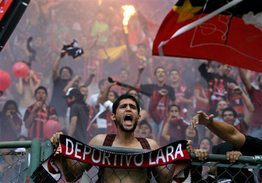 A fan of Venezuela&#39;s Deportivo Lara cheers his team during a Copa Libertadores soccer match against Argentina&#39;s Newell&#39;s in Barquisimeto, Venezuela, Thursday, Feb. 21, 2013. &#40;AP Photo&#47;Fernando Llano&#41; <span class=meta>(AP Photo&#47; Fernando Llano)</span>