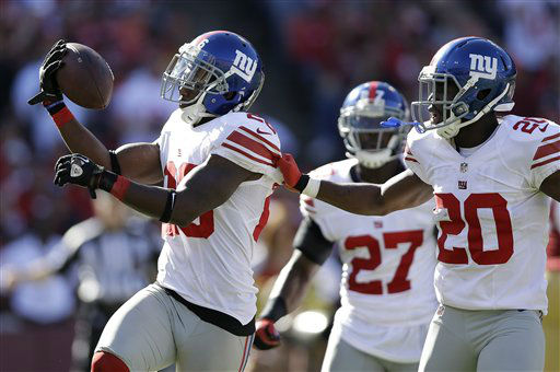 New York Giants free safety Antrel Rolle, left, celebrates with cornerback Prince Amukamara &#40;20&#41; after intercepting San Francisco 49ers quarterback Alex Smith during the third quarter of an NFL football game in San Francisco, Sunday, Oct. 14, 2012. &#40;AP Photo&#47;Marcio Jose Sanchez&#41; <span class=meta>(AP Photo&#47; Marcio Jose Sanchez)</span>