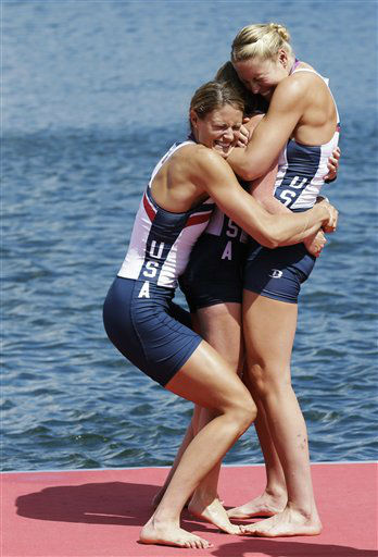 "<div class=""meta ""><span class=""caption-text "">Members of the U.S. women's eight team embraces coxswain Mary Whipple after winning the gold medal in Eton Dorney, near Windsor, England, at the 2012 Summer Olympics, Thursday, Aug. 2, 2012. (AP Photo/Natacha Pisarenko) (AP Photo/ Natacha Pisarenko)</span></div>"