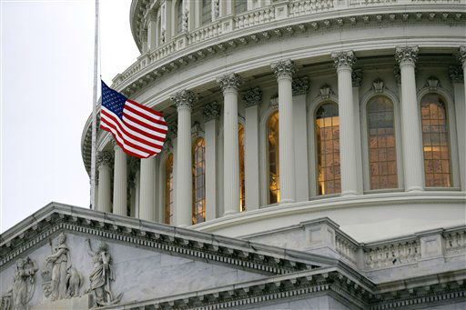 The flag on the East Front of the U.S. Capitol is lowered to half-staff on Capitol Hill, Monday, April 15, 2013, in Washington, after the explosions at the Boston Marathon. (AP Photo/Alex Brandon)