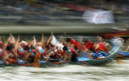 The helmsman steadily steers his boat during the annual Chinese traditional Dragon Boat Festival races in Taipei, Taiwan, Wednesday, June 12, 2013. Dragon boat races are in remembrance of Chu Yuan, an ancient Chinese scholar-statesman, who drowned in 277 B.C. while denouncing government corruption. (AP Photo/Wally Santana)