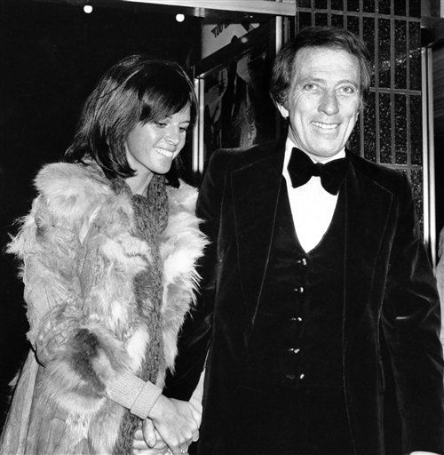 "<div class=""meta image-caption""><div class=""origin-logo origin-image ""><span></span></div><span class=""caption-text"">FILE - In a Dec. 19, 1974 file photo, American singer Andy Williams and his wife Claudine Longet, shown upon arrival at the Odeon, Leicester Square, London, for the Royal Charity World premiere of ""The Man With the Golden Gun."" Emmy-winning TV host and ""Moon River"" crooner Williams died Tuesday night, Sept, 25, 2012 at his home in Branson, Mo., following a year-long battle with bladder cancer. He was 84. (AP Photo/Press Association, File) (AP Photo/ Anonymous)</span></div>"