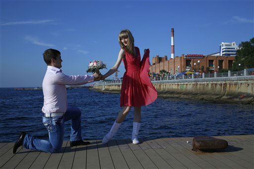 A couple poses foe a picture at a waterfront in the eastern Russian city of Vladivostok, Monday, Sept. 10, 2012. &#40;AP Photo&#47;Vincent Yu&#41; <span class=meta>(AP Photo&#47; Vincent Yu)</span>