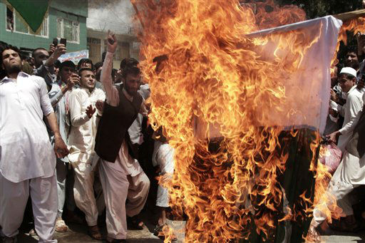 "<div class=""meta ""><span class=""caption-text "">Afghans chanting ""death to Pakistan""  burn a Pakistani flag during a demonstration in Asad Abad, Kunar province, east of Kabul, Afghanistan, Tuesday, May 14, 2013. Relations between Afghanistan and Pakistan have been severely strained in recent months and the mountainous region in eastern Afghanistan has seen acrimonious exchanges of fire between the two sides over the demarcation of their border. (AP Photo/Rahmat Gul) (AP Photo/ Rahmat Gul)</span></div>"