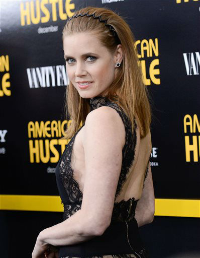 FILE - This Dec. 8, 2013 file photo shows actress Amy Adams at the premiere of &#34;American Hustle&#34; at the Ziegfeld Theatre in New York.  Adams was nominated for a Golden Globe for best actress in a motion picture drama for her role in the film on Thursday, Dec. 12, 2013.  The 71st annual Golden Globes will air on Sunday, Jan. 12. &#40;Photo by Evan Agostini&#47;Invision&#47;AP, File&#41; <span class=meta>(Photo&#47;Evan Agostini)</span>
