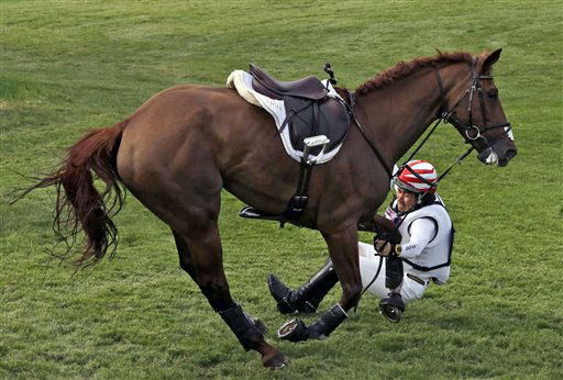 Yoshiaki Oiwa of Japan riding Noonday de Conde falls during competition in the equestrian eventing cross-country stage at the 2012 Summer Olympics, Monday, July 30, 2012, in London. &#40;AP Photo&#47;Ng Han Guan&#41; <span class=meta>(AP Photo&#47; Ng Han Guan)</span>