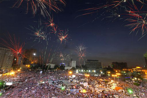 Fireworks burst over opponents of Egypt's Islamist President Mohammed Morsi in Tahrir Square in Cairo, Egypt, Tuesday, July 2, 2013. With a military deadline for intervention ticking down, protesters seeking the ouster of Egypt's Islamist president sought Tuesday to push the embattled leader further toward the edge with another massive display of people power. (AP Photo/Amr Nabil)
