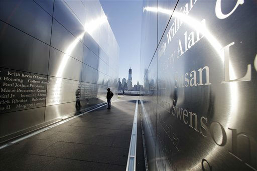 A person stops to read names in New Jersey&#39;s memorial to the 749 people from the state lost during the  Sept. 11 terrorist attacks on the World Trade Center, as One World Trade Center, now up to 104 floors, looms in the distance across the Hudson River, Tuesday, Sept. 11, 2012 in Jersey City, N.J.  Americans paused again Tuesday to mark the 11th anniversary of the Sept. 11, 2001, terror attacks with familiar ceremonies, but also a sense that it&#39;s time to move forward after a decade of remembrance. &#40;AP Photo&#47;Mel Evans&#41; <span class=meta>(AP Photo&#47; Mel Evans)</span>