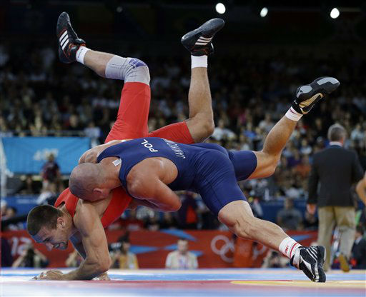 Amer Hrustanovic of Austria competes against Damian Janikowski of Poland &#40;in blue&#41; during the 84-kg Greco-Roman wrestling competition at the 2012 Summer Olympics, Monday, Aug. 6, 2012, in London. &#40;AP Photo&#47;Paul Sancya&#41; <span class=meta>(AP Photo&#47; Paul Sancya)</span>