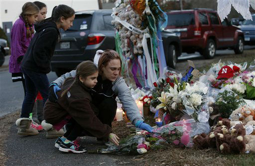 "<div class=""meta image-caption""><div class=""origin-logo origin-image ""><span></span></div><span class=""caption-text"">Mourners pay their respects at a memorial for shooting victims near Sandy Hook Elementary School, Saturday, Dec. 15, 2012 in Newtown, Conn.  A gunman walked into Sandy Hook Elementary School in Newtown Friday and opened fire, killing 26 people, including 20 children. (AP Photo/Jason DeCrow) (AP Photo/ Jason DeCrow)</span></div>"