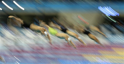 "<div class=""meta ""><span class=""caption-text "">Swimmers start in a men's 100-meter freestyle swimming heat at the Aquatics Centre in the Olympic Park during the 2012 Summer Olympics in London, Tuesday, July 31, 2012. (AP Photo/Matt Slocum) (AP Photo/ Matt Slocum)</span></div>"