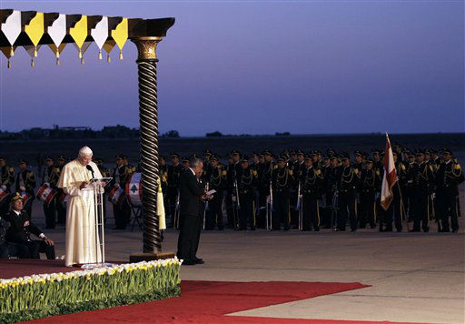 "Pope Benedict XVI, left, addresses a speech in front of Lebanese honor guards during his departure ceremony, at Rafik Hariri International airport, in Beirut, Lebanon, Sunday Sept. 16, 2012. Pope Benedict XVI end his three days visit to Lebanon after he celebrated an open-air mass for tens of thousands of pilgrims from across the Middle East, saying Christians must do their part to end the ""grim trail of death and destruction"" in the region. (AP Photo/Hussein Malla)"