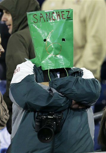 A New York Jets fan wears a bag over his head with the name of quarterback Mark Sanchez in the fourth quarter of an NFL football game against the Tennessee Titans on Monday, Dec. 17, 2012, in Nashville, Tenn. The Titans won 14-10. &#40;AP Photo&#47;Wade Payne&#41; <span class=meta>(AP Photo&#47; Wade Payne)</span>