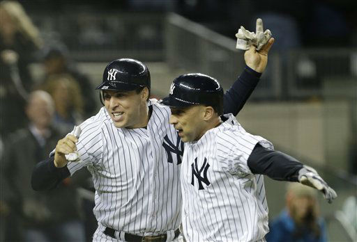 New York Yankees&#39; Mark Teixeira, left, and  teammate Raul Ibanez celebrate after Ibanez hit a two-run home run in the ninth inning of Game 1 of the American League championship series against the Detroit Tigers Saturday, Oct. 13, 2012, in New York. &#40;AP Photo&#47;Paul Sancya &#41; <span class=meta>(AP Photo&#47; Paul Sancya)</span>