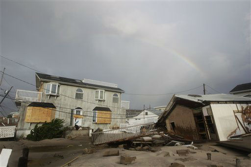 Damage from flooding at Breezy Point after superstorm Sandy Tuesday, Oct. 30, 2012, in the New York City borough of Queens.The fire destroyed between 80 and 100 houses Monday night in the flooded neighborhood. &#40;AP Photo&#47;Frank Franklin II&#41; <span class=meta>(AP Photo&#47; Frank Franklin II)</span>