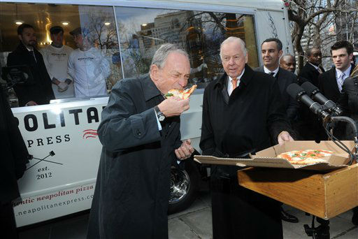 New York CIty Mayor Michael Bloomberg, left, samples Neapolitan pizza as legendary energy executive T. Boone Pickens, right, looks on at the unveiling of Neapolitan Express, the first mobile food truck fully-powered by compressed natural gas, Thursday, Feb. 21, 2013, at City Hall Park in New York. <span class=meta>(Diane Bondareff&#47;Invision for Neapolitan Express&#47;AP Images)</span>