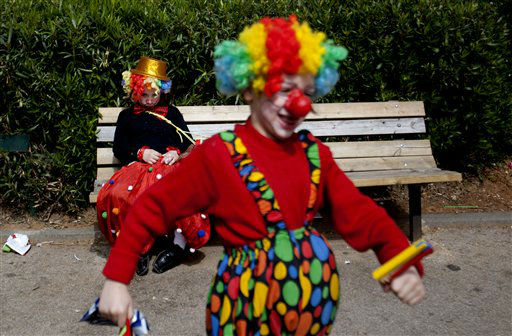 "<div class=""meta ""><span class=""caption-text "">Two Ultra Orthodox Jewish boys dress as clowns during the Purim festival in the ultra-Orthodox town of Bnei Brak, Israel, Sunday, Feb. 24, 2013. The Jewish holiday of Purim commemorates the Jews' salvation from genocide in ancient Persia, as recounted in the Book of Esther which is read in synagogues. Other customs include: sending food parcels and giving charity, dressing up in masks and costumes, eating a festive meal, and public celebration. (AP Photo/Ariel Schalit)</span></div>"