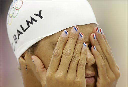 French swimmer Coralie Balmy wears nail polish in the colors of the national flag as she prepares for a practice session at the Aquatics Centre in the Olympic Park ahead of the 2012 Summer Olympics, Friday, July 27, 2012, in London. &#40;AP Photo&#47;Daniel Ochoa De Olza&#41; <span class=meta>(AP Photo&#47; Daniel Ochoa De Olza)</span>
