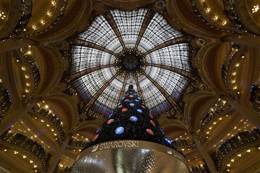 "<div class=""meta image-caption""><div class=""origin-logo origin-image ""><span></span></div><span class=""caption-text"">A Christmas tree is seen in the main hall of the Galeries Lafayette department store in Paris, Tuesday, Dec. 18, 2012. (AP Photo/Michel Euler) (AP Photo/ Michel Euler)</span></div>"