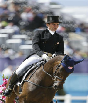 Phillip Dutton from the United States competes with his horse Mystery Whisper in the equestrian eventing dressage phase during the equestrian eventing competition at Greenwich Park, at the 2012 Summer Olympics, Sunday, July 29, 2012, in London. &#40;AP Photo&#47;Markus Schreiber&#41; <span class=meta>(AP Photo&#47; Markus Schreiber)</span>