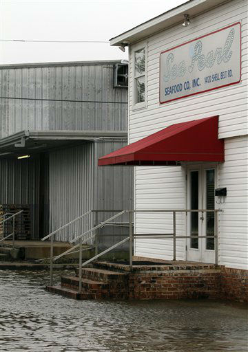"<div class=""meta ""><span class=""caption-text "">Flooding reaches the door steps of the Sea Pearl Seafood company on Shell Belt Road in Bayou La Batre, Ala.  on Tuesday, Aug.  28, 2012.  The U.S. National Hurricane Center in Miami said Isaac became a Category 1 hurricane Tuesday with winds of 75 mph. It could get stronger by the time it's expected to reach the swampy coast of southeast Louisiana. (AP Photo/Butch Dill) (AP Photo/ Butch Dill)</span></div>"